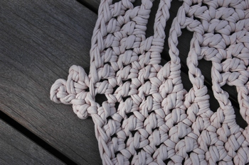 Weave in ends by grabbing the yarn with a smaller sized hook.